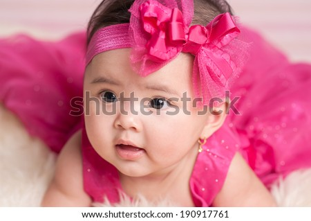 A close up of adorable portrait baby girl - stock photo