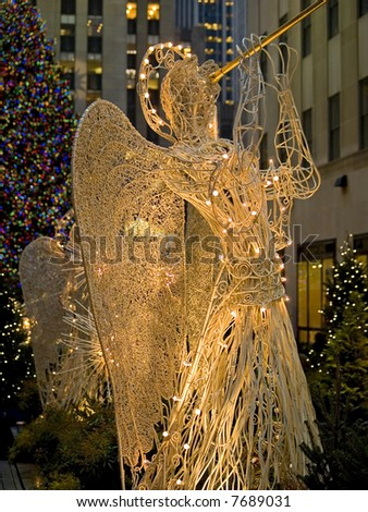 A close-up of an angel decoration at Rockefeller Center in New York City. - stock photo