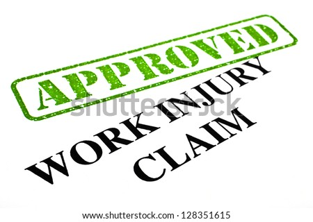 A close-up of an APPROVED Work Injury Claim document. - stock photo