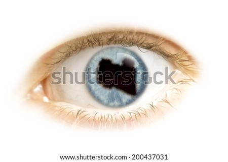 A close-up of an eye with the pupil in the shape of Libya.(series) - stock photo