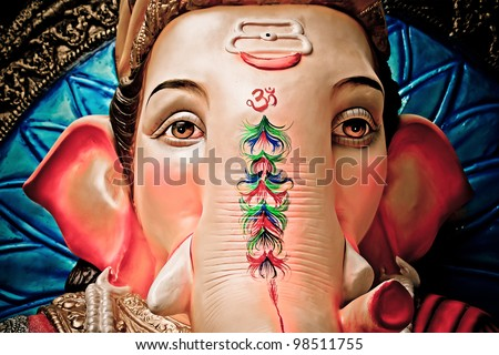 A close-up of an idol of Lord Ganesha - stock photo
