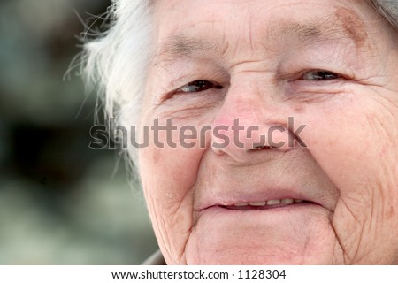 a close up of an old woman's face.