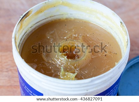 A close-up of an open tub of lithium grease