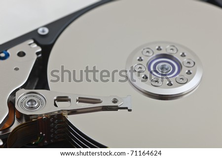 A close up of an opened computer hard disk