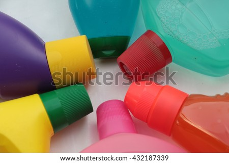 A close up of colorful detergent bottles - stock photo