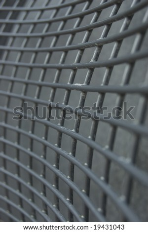 a close up of corroded steel mesh - stock photo