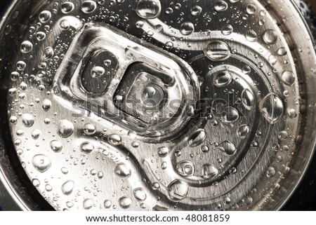 A close up of drink`s tin with drops on steel top - stock photo