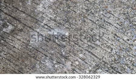 A close up of gray grunge textured floor with white stain. Picture can be used as a background. - stock photo
