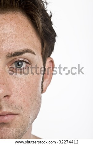 A close up of half of a mans face - stock photo