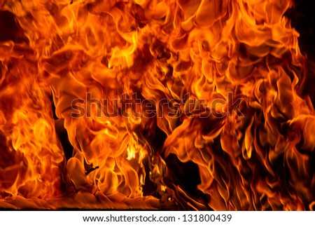 A close up of intense red flames in a fire - stock photo