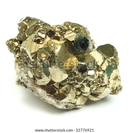 A close up of iron pyrite mineral isolated on white background. - stock photo
