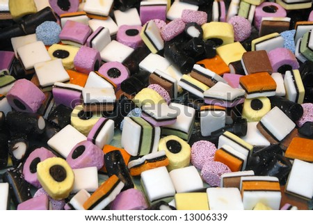 A close up of licorice all sorts sweets
