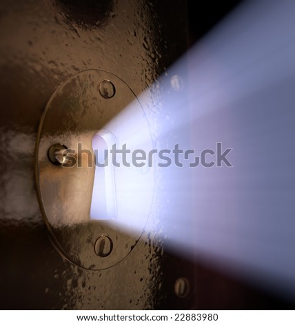 A close-up of light pouring out of a key hole.