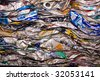 a close up of metal drink cans squashed for recycling - stock photo