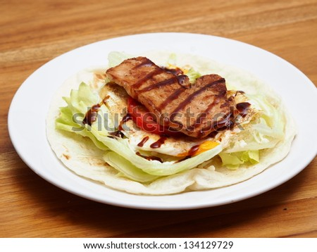 A close up of mexican tortilla with pork - stock photo