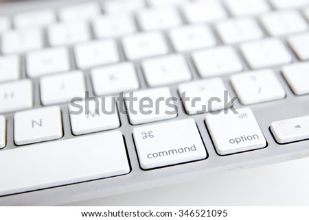 A Close up of modern white aluminum keyboard with soft focus.