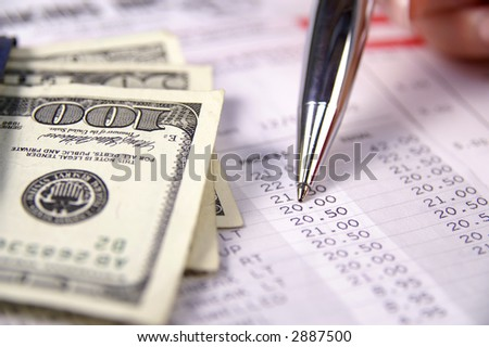 A close-up of money and a receipt - stock photo