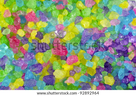 A close up of multicolored crystal rock candy.