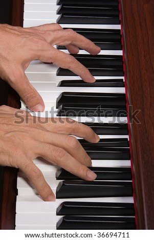 A Close Up Of Playing A Piano - stock photo