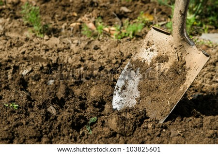 a close up of shovel in the ground - stock photo