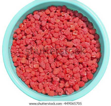 A close up of the bucket with raspberry berries. Isolated on white. - stock photo