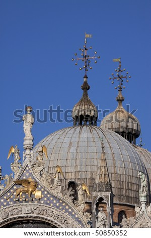 A close-up of the domes of the famous Saint Mark's Basilica on Saint Mark's Square in Venice, Italy.