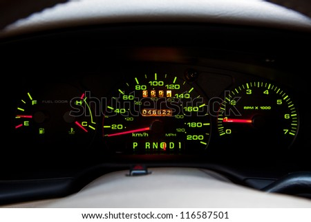 A close up of the front instrument panel or dashboard of a modern automobile. - stock photo
