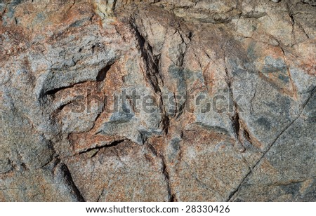 A close up of the rough surface of granite.