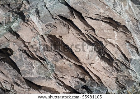 A close up of the surface of the grey stone. - stock photo