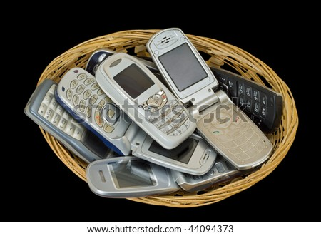 A close up of the telephones in small basket. Isolated on black.
