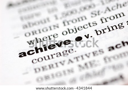 A close up of the word achieve from a dictionary - stock photo