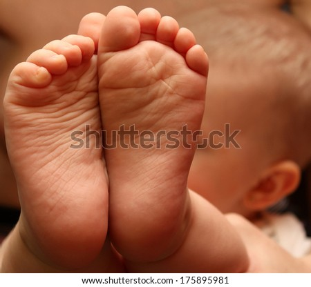 A close-up of tiny baby feet - stock photo