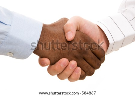 A close-up of two hands (different races) shaking - stock photo