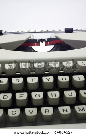 a close up of typewriter, deep depth of field. - stock photo