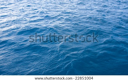 A close up of water to be used for a background or backdrop - stock photo