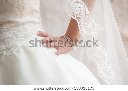 A close up on a bride hand. - stock photo
