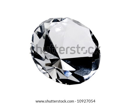 A close up on a diamond isolated on a white background. Shallow DOF. - stock photo