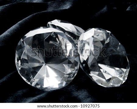 A close up on a diamond on a dark background. - stock photo
