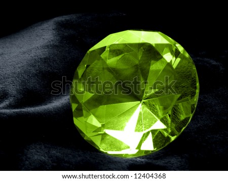 A close up on a Emerald jewel on a dark background. Shallow DOF. - stock photo