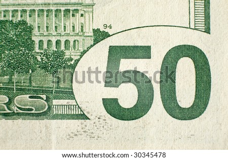 A close up on a fifty dollar bill. Shallow depth of field. - stock photo