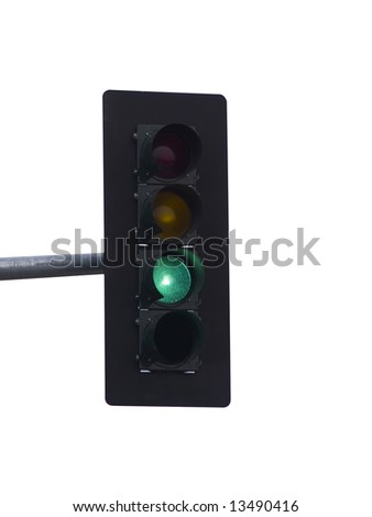 A close up on a green traffic light isolated on a white background. - stock photo