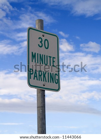 A close up on a 30 Minute Parking sign