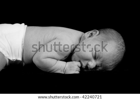 A close up on a newborn baby boy. Ten days old.