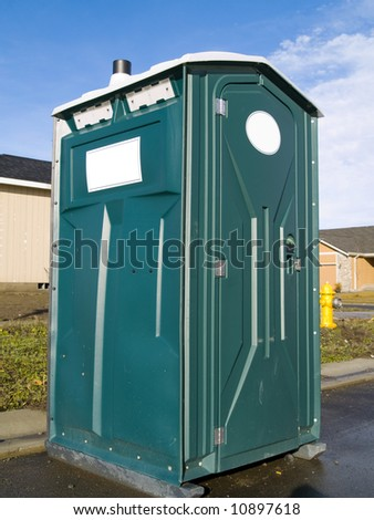 A close up on a plastic outhouse. - stock photo