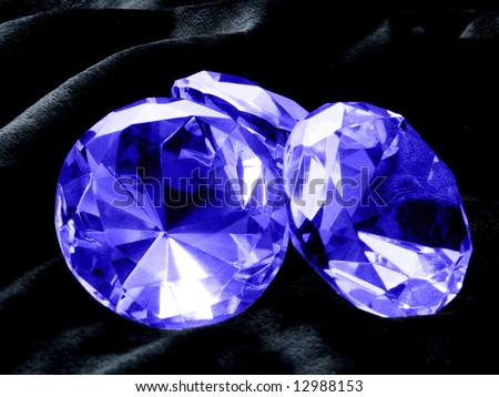 A close up on a Sapphire jewel on a dark background. Shallow DOF. - stock photo