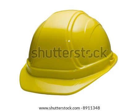 A close up on a yellow hard hat isolated on a white background. - stock photo