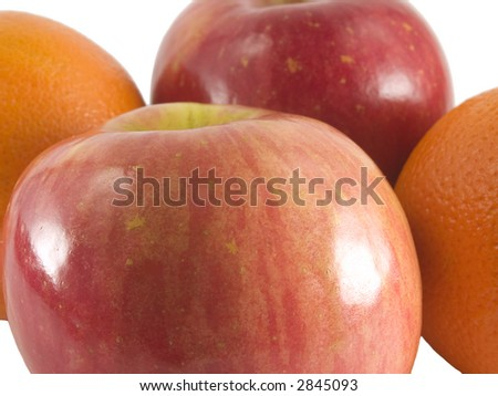 a close up on fuji apples and cara cara oranges isolated on a white background - stock photo