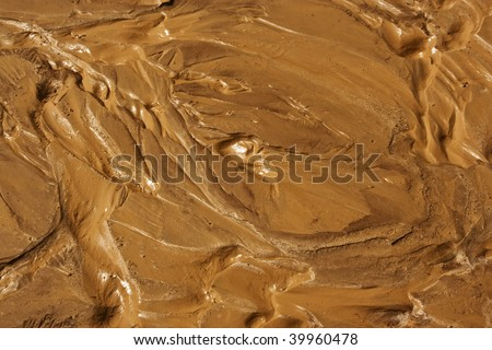 a close-up pattern of mud after heavy rain - stock photo
