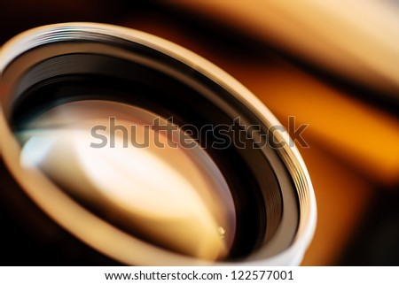 A close-up photo of a fast aperture lens for SLR camera shot with shallow depth of field