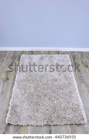 A close up photo of a plush floor rug - stock photo
